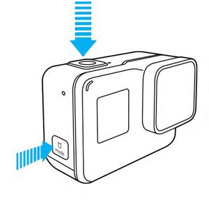 La GoPro Hero ha lo SHUTTER button SOPRA ed il MODE button sul lato DESTRO